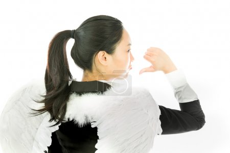 Rear view of angel side of a young Asian businesswoman showing thumbs down sign and looking disappointed isolated on white background