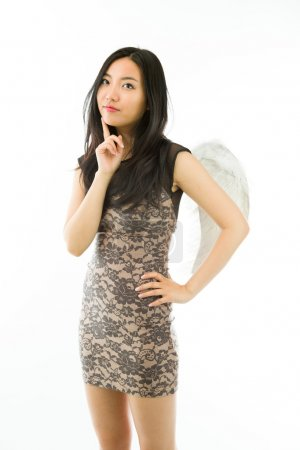 Asian young woman dressed up as an angel standing with her hand on hip isolated on white background