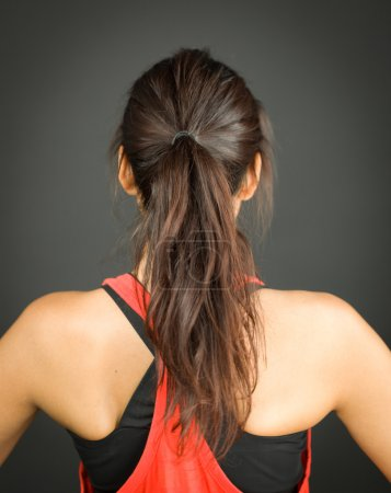 Rear view of a young woman with ponytail