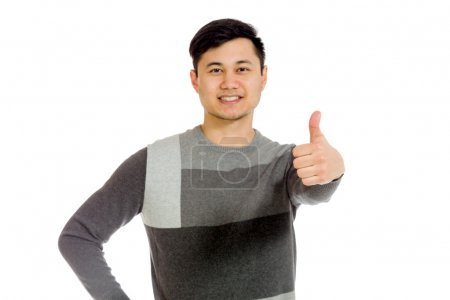 Model gestuirng thumb up sign