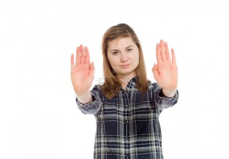 Model gesturing stop sign with hands