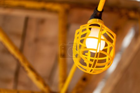 Scaffolding in building with electric bulb