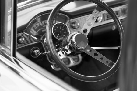 Black steering wheel of a classic car