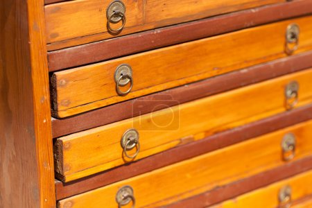 Wooden chest drawers at flea market