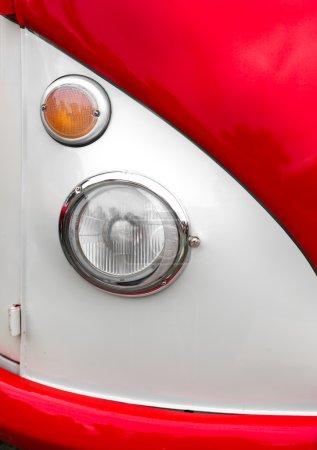 Headlight of shiny classic vintage car