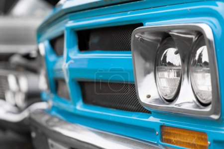 Right headlights of a blue vintage car