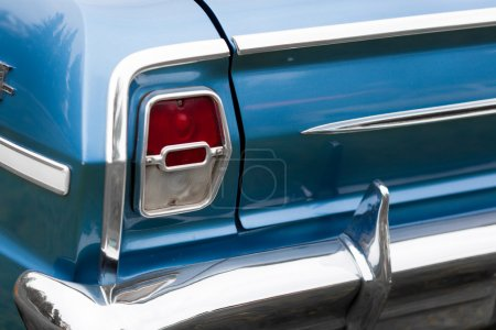 Right tail light of a blue vintage car