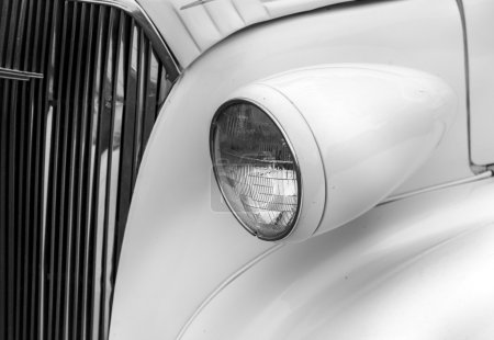 Right headlights of a white vintage car