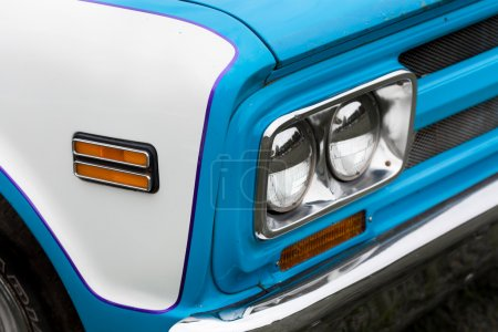 Left headlights of a classic vintage car