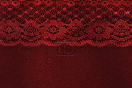 Photo for Red lace on red velvet paper background - Royalty Free Image