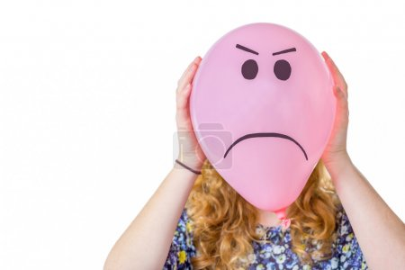 Pink balloon with expression in front  of girls face