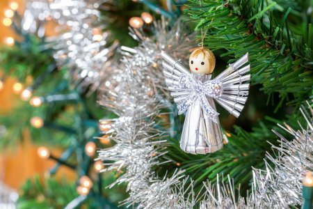 Little angel hanging in Christmas tree