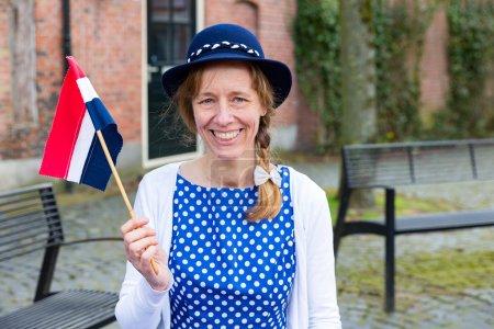European woman celebrating liberation with dutch flag