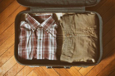mens shirt and pants in vintage suitcase