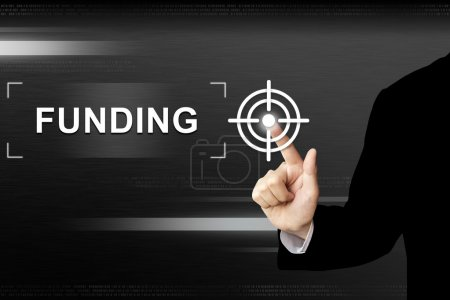 Business hand clicking funding button on a touch s...