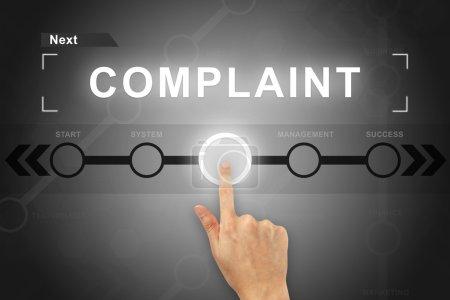 Photo pour Clic main bouton de plainte sur un écran tactile - image libre de droit