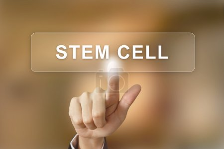 business hand clicking stem cell button on blurred background