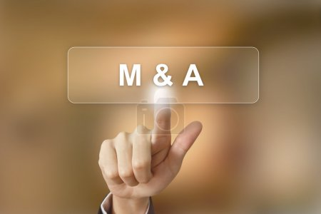 Business hand clicking merger and acquisition button on blurred