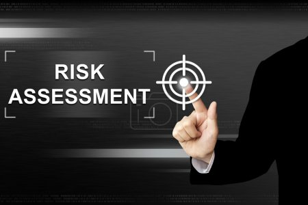 Business hand pushing risk assessment button on touch screen