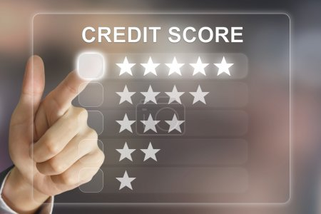 business hand pushing credit score on virtual screen