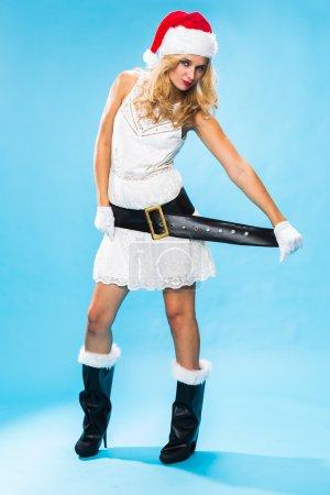 Cute sexy blond woman in a Santa hat