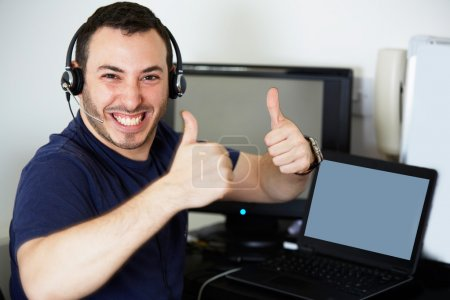 Happy call centre worker giving a thumbs up