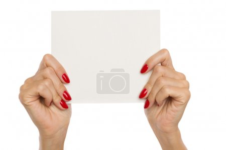 Woman's Hands Showing Blank Paper Sheet