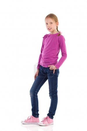 Photo for Little girl posing with hand in pocket. Full length studio shot isolated on white. - Royalty Free Image