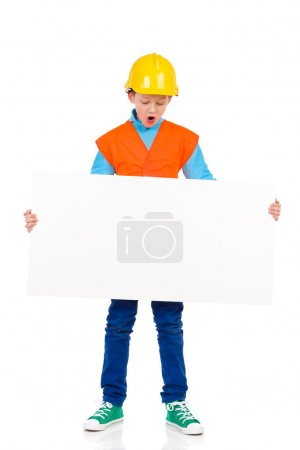 Little construction worker with placard