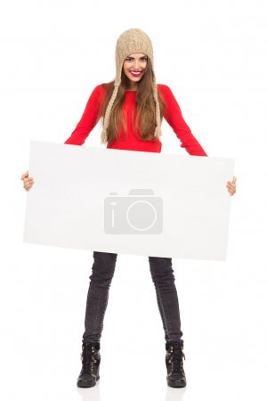 Smiling Woman In Winter Cap Holding Poster