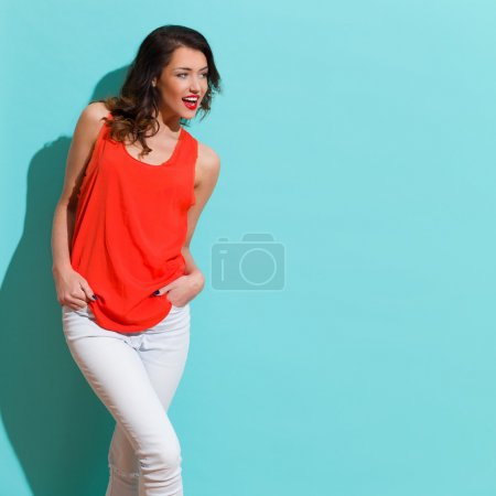Shouting Woman In Red Shirt On Turquoise Background