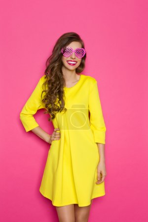 Happy Young Woman In Pink Sunglasses