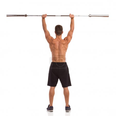 Strong Man With Barbell Back View