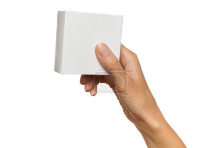 Woman's Hand Holding White Box