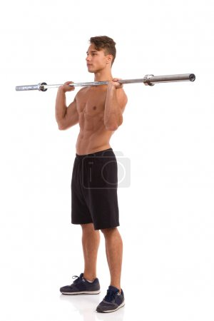 Fit Man Holding Barbell On His Shoulders