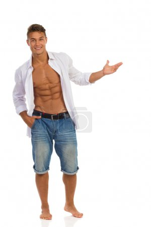 Fit Man In Unbuttoned Shirt Presenting Something