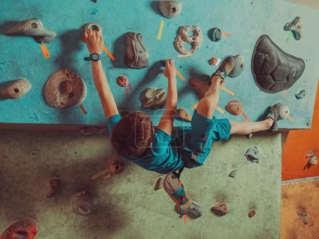 Boy training in climbing gym