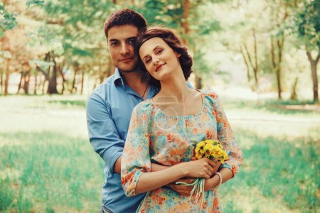 couple in love with bouquet of dandelions