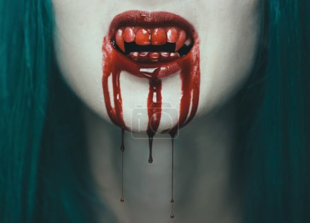Scary vampire woman, close-up of mouth with teeth ...
