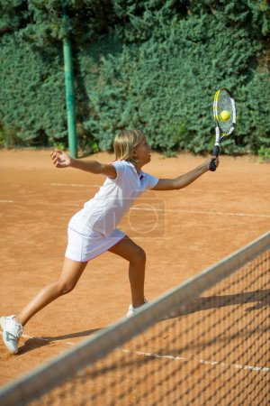 Athlete girl on training tennis