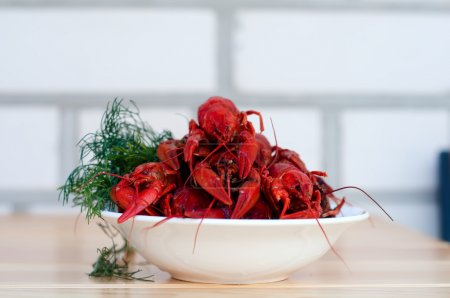 Boiled crayfishes with greenery on a plate