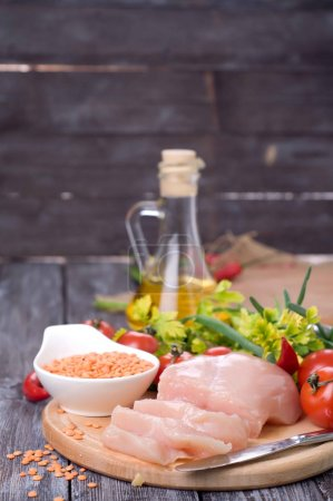 Photo for Ingredients for lentil stew with chicken and vegetables - Royalty Free Image
