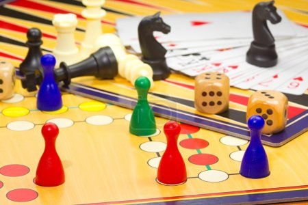 Photo for Photo shows a closeup of a various board games including chess and cards. - Royalty Free Image
