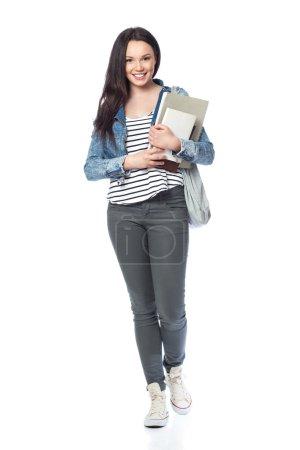 Photo pour Jeune étudiante debout avec des livres et des sacs, isolée sur blanc - image libre de droit