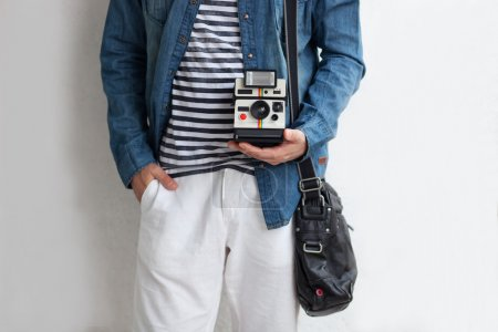 Hipster  with instant camera