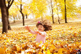 Girl having autumn fun