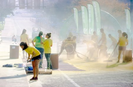 Workers cleaning up yellow