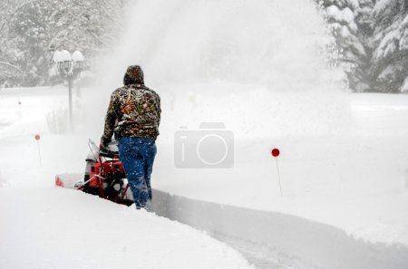 Snow blowing deep snow