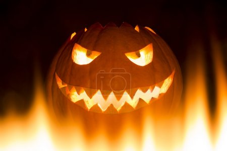 The big helloween pumpkin has a mad face with glow...