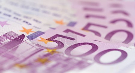 Close up from stack of money with 500 euro banknotes